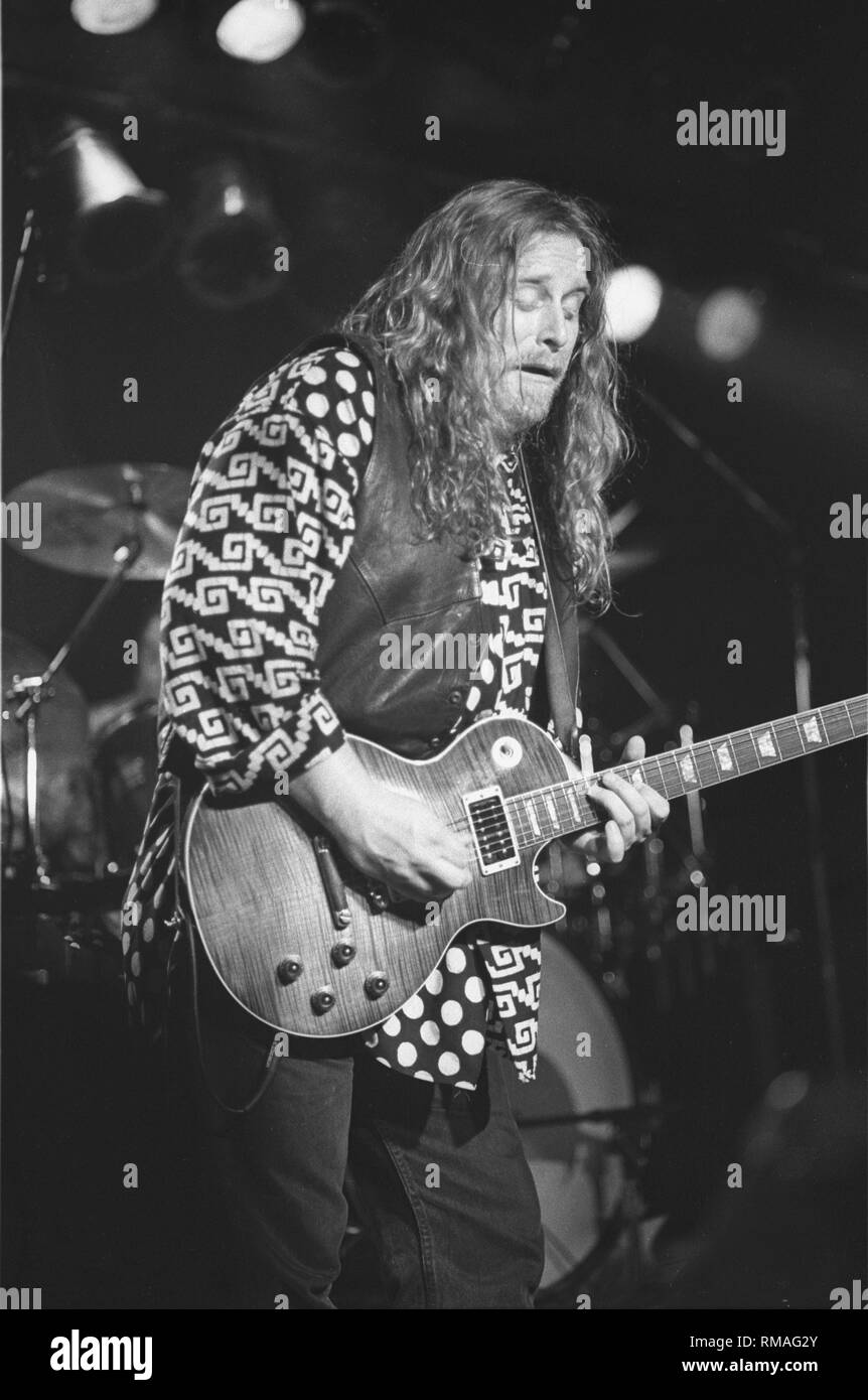 Guitarist, singer and songwriter Warren Haynes is shown performing on stage during a 'live' concert appearance. - Stock Image