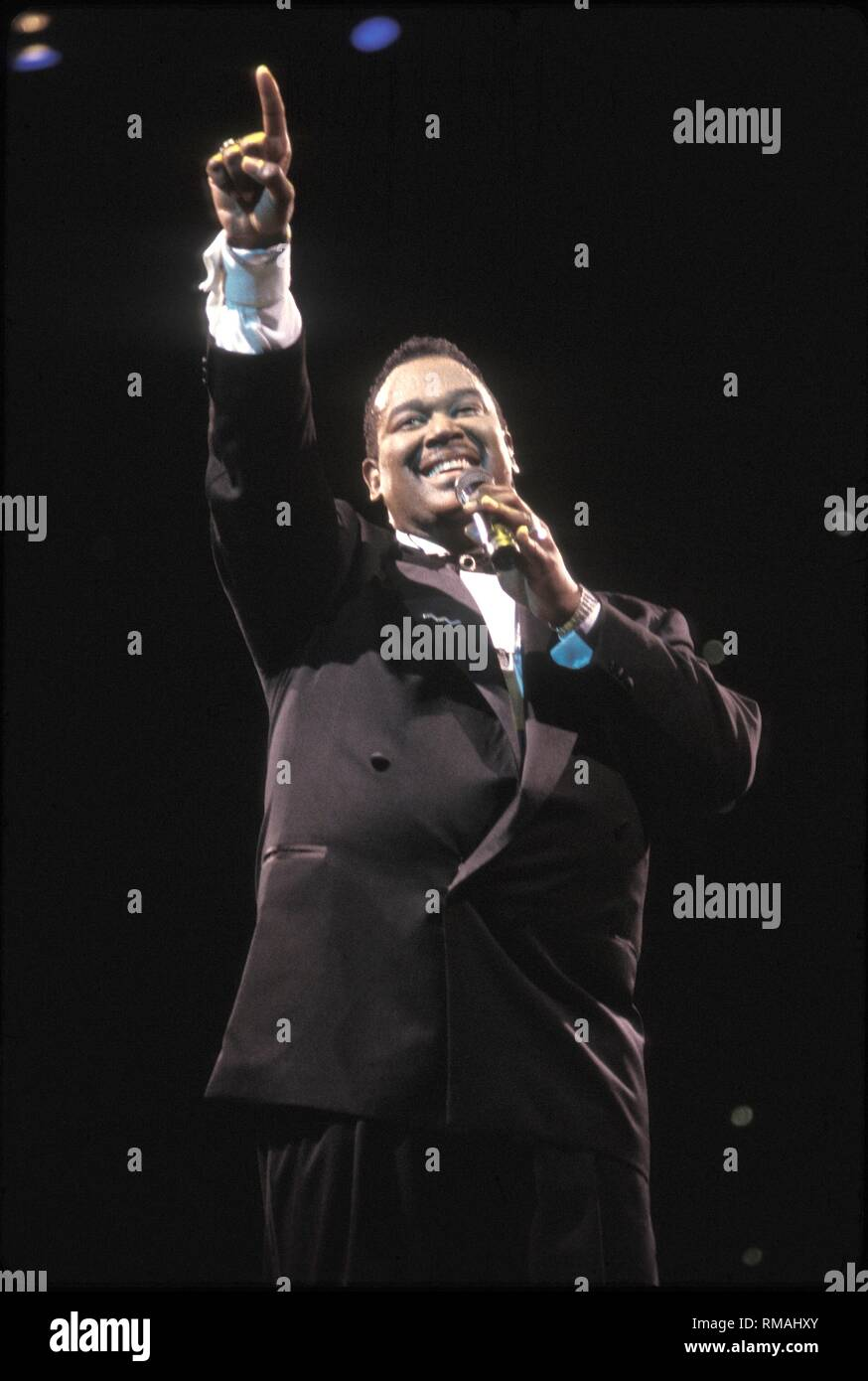 "R&B and soul singer, songwriter, and record producer Luther Vandross is shown performing onstage during a ""live"" concert appearance. Stock Photo"