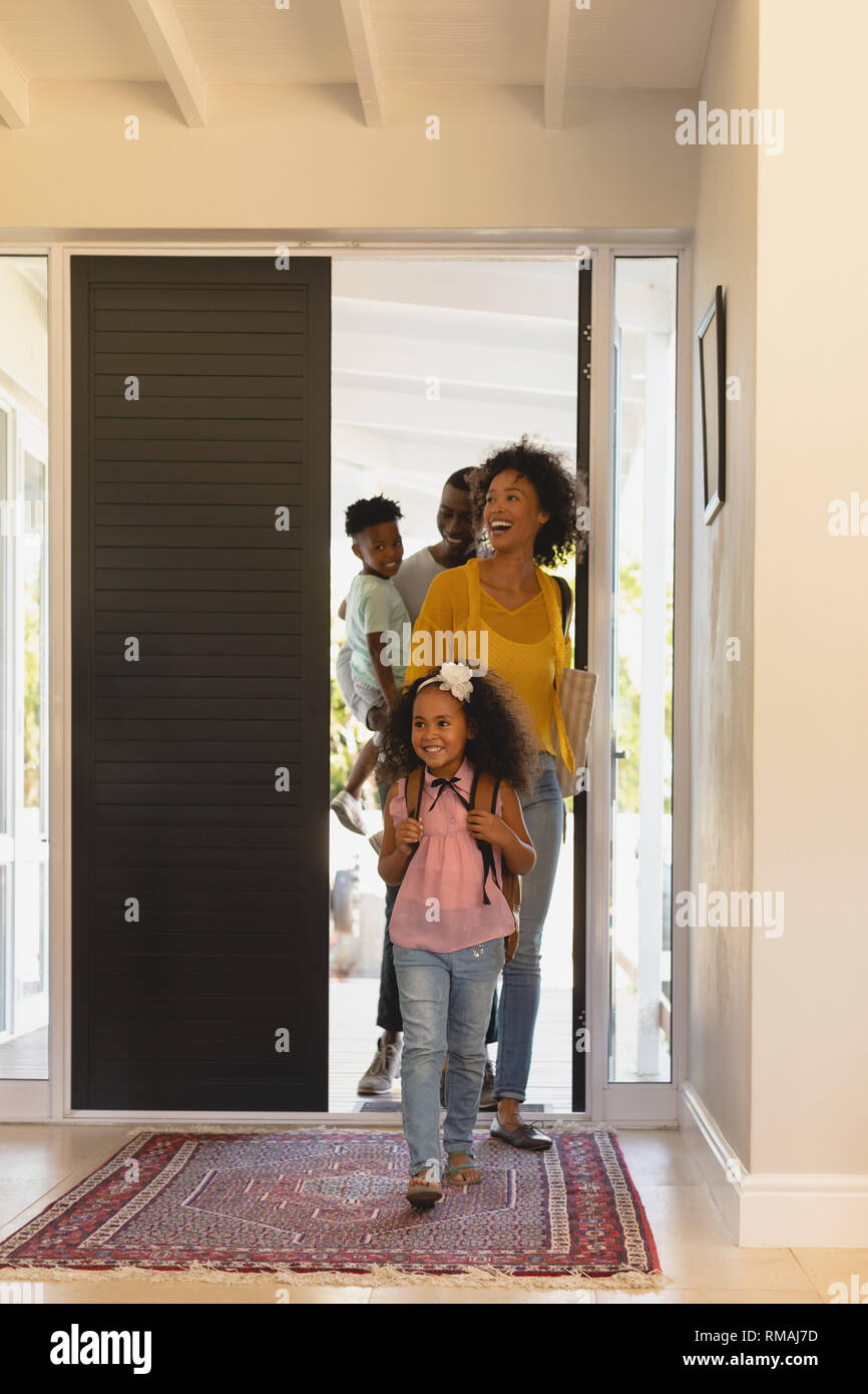 Happy African American family returning sweet home - Stock Image
