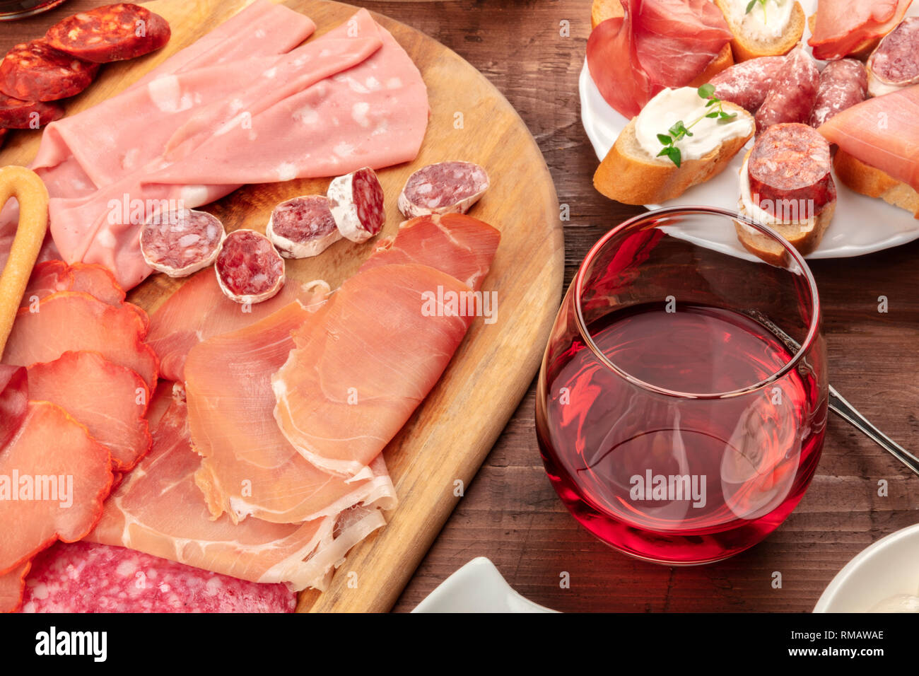 A Glass Of Wine With A Cold Cuts Platter And Sandwiches Tapas In A Bar Stock Photo Alamy
