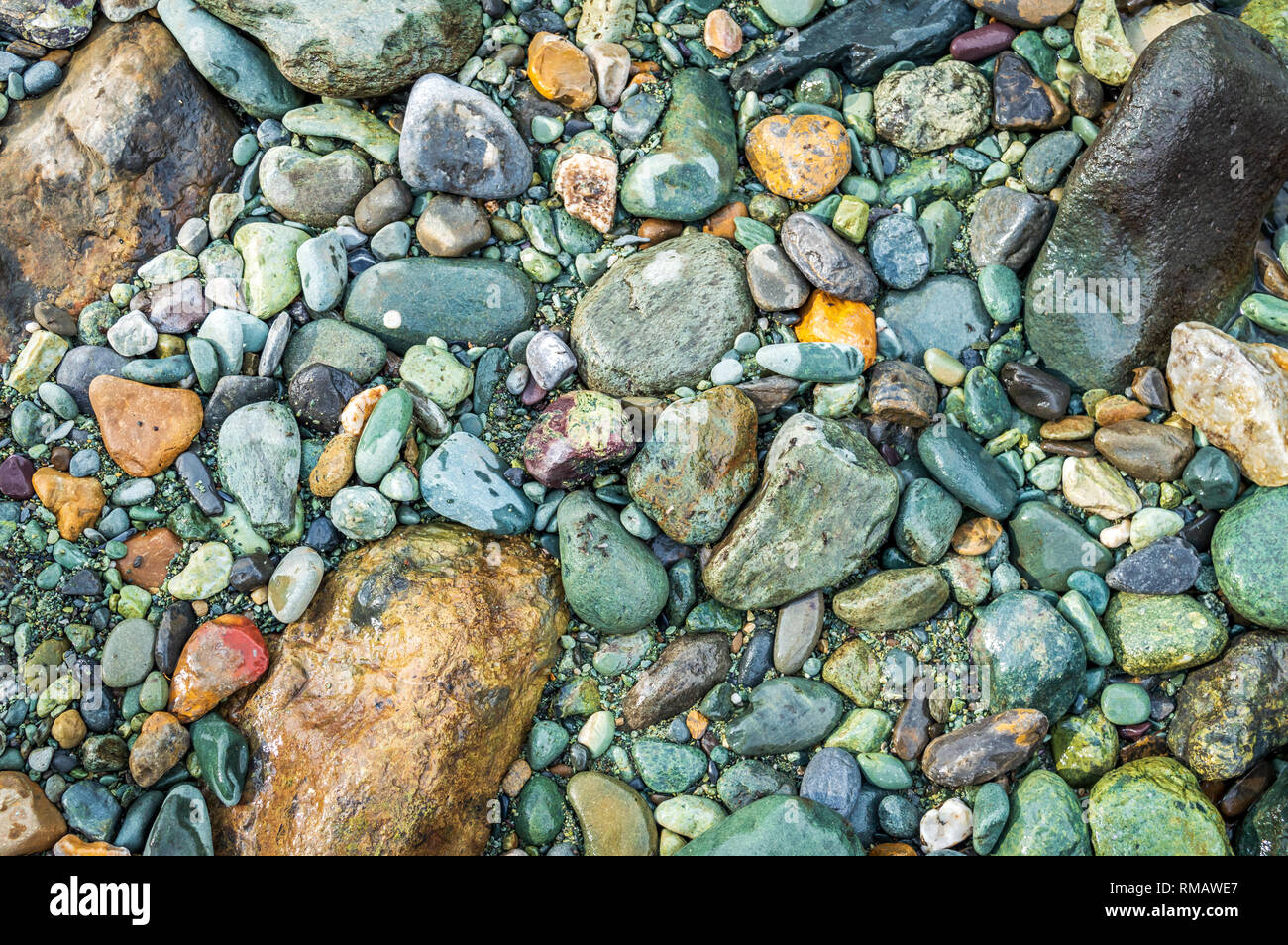 A coarse surface. Groung covered with pebbles. Rough terrain - Stock Image