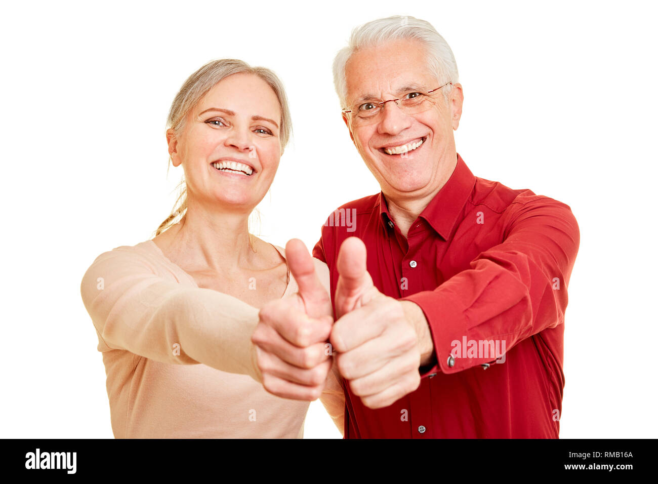Two seniors as a winner couple keeps their fingers crossed - Stock Image