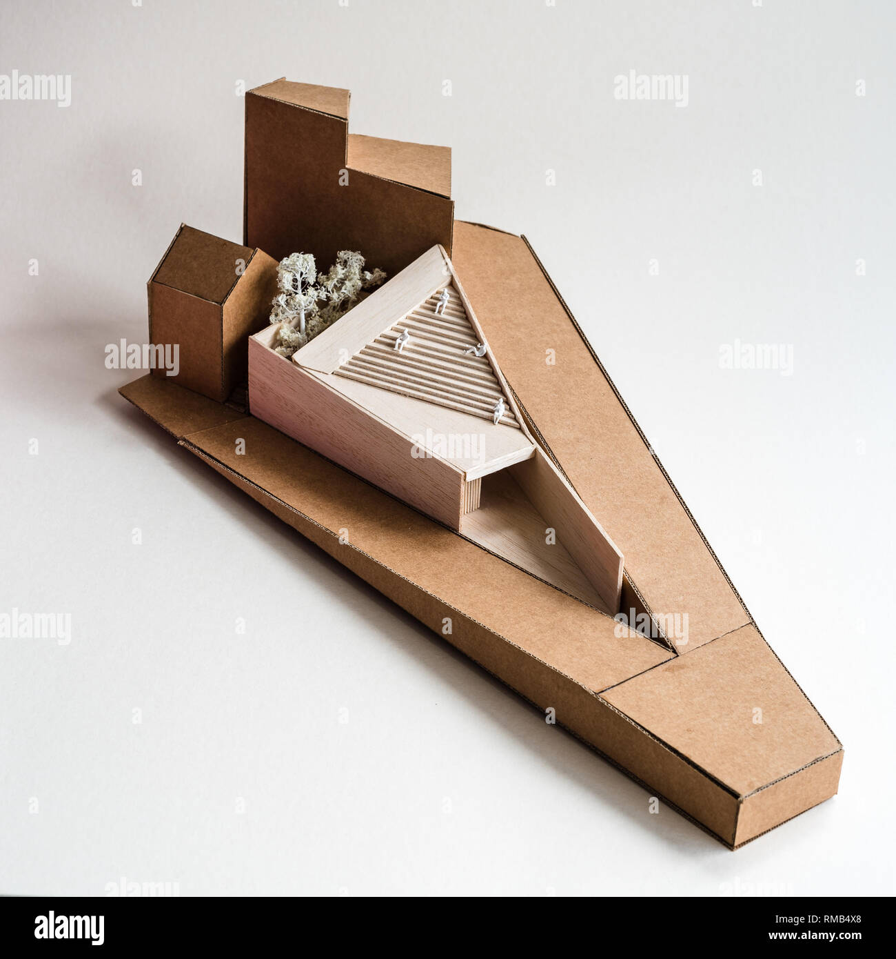 Modern architecture model made with wood and cardboard on white background - Stock Image