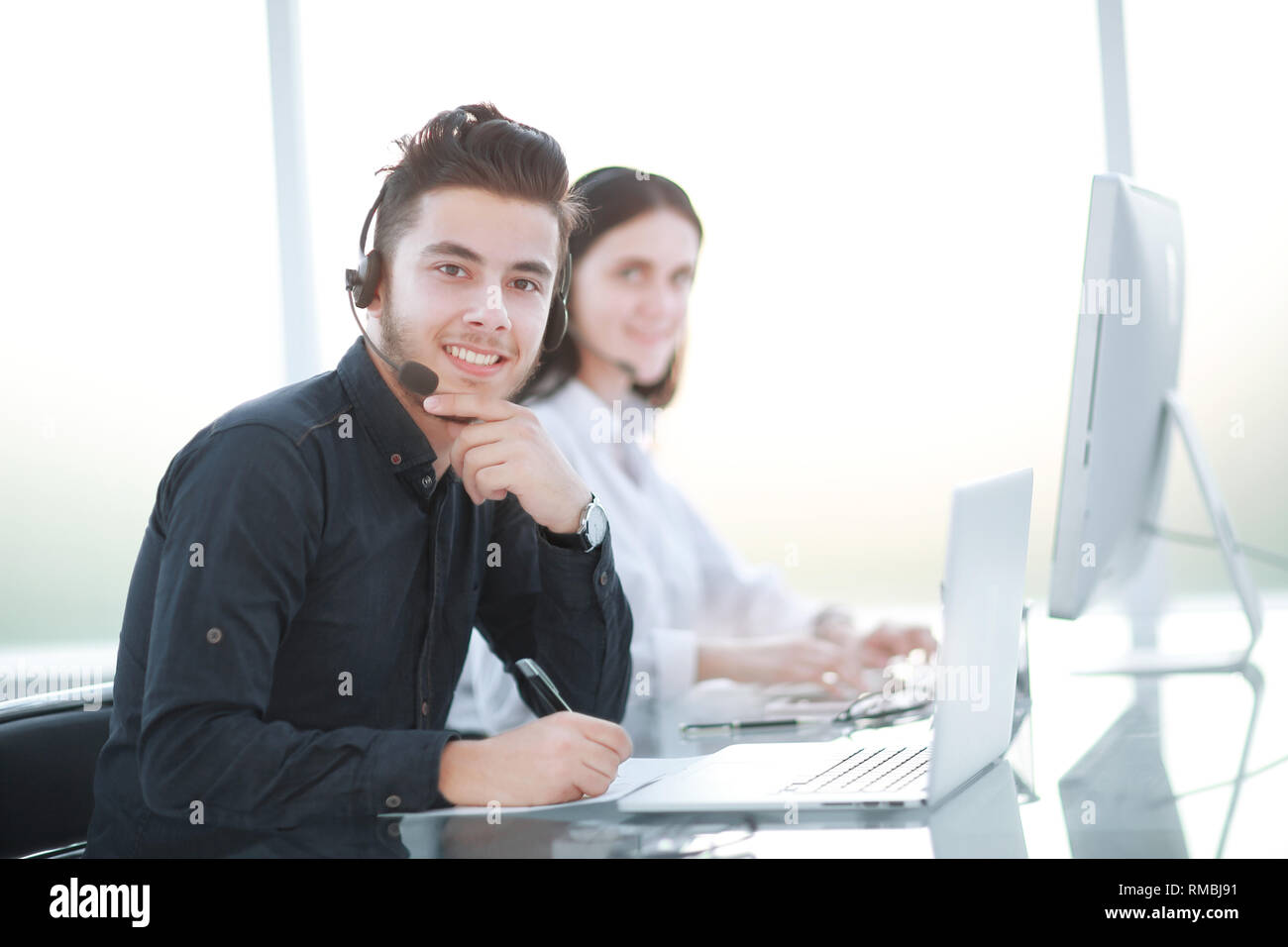 professional workers call center in the workplace Stock Photo