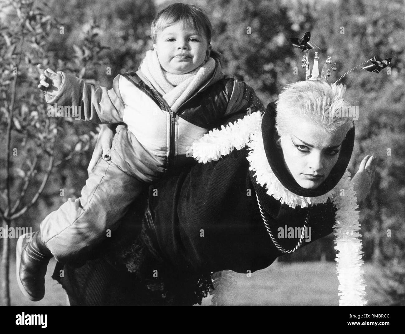 The singer Nina Hagen with her daughter Cosma Shiva on her back. - Stock Image