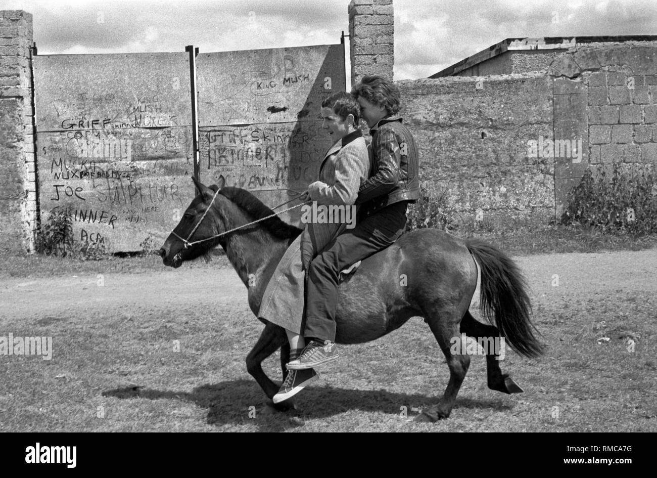 Limerick, in County Limerick Eire. 1970s daily life teenage boys riding a urban horse West Coast of Southern Ireland 70s HOMER SYKES - Stock Image