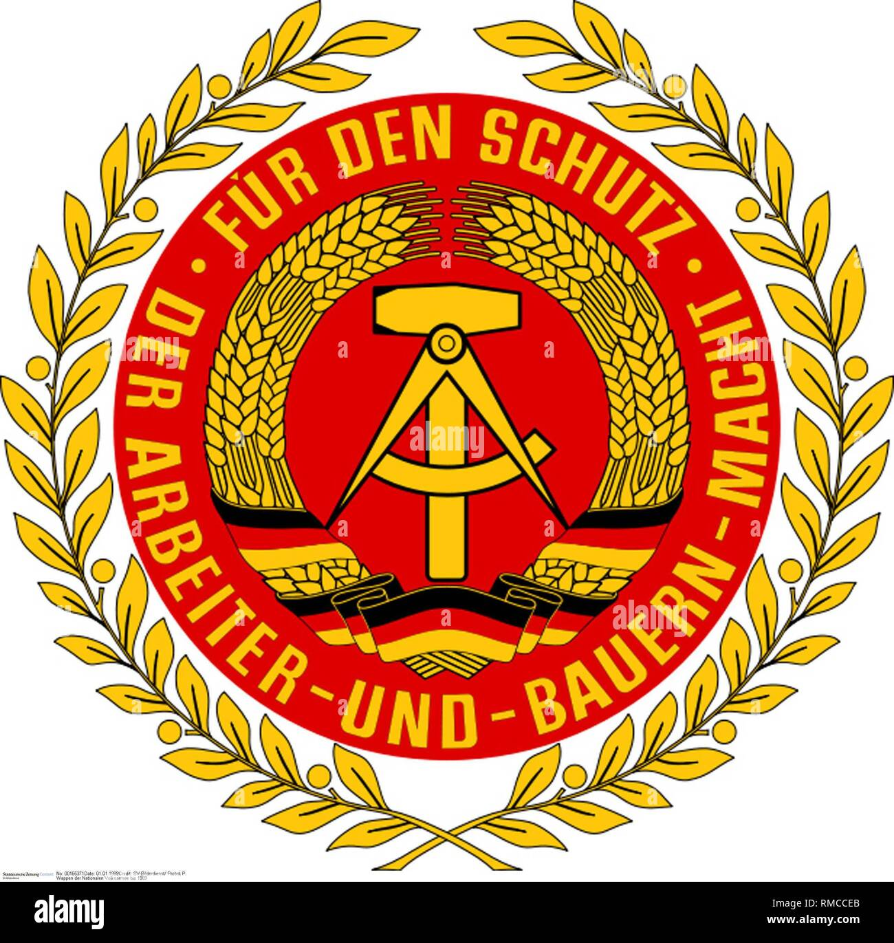 Coat of arms of the National People's Army of the GDR with the national coat of arms of the GDR in the middle. Photo from 1989. - Stock Image