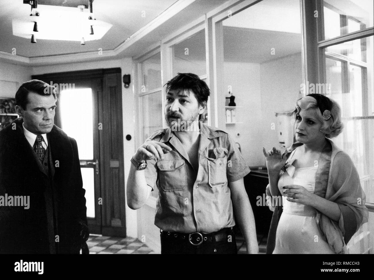 Andréa Ferréol rainer werner fassbinder (center) gives direction to the