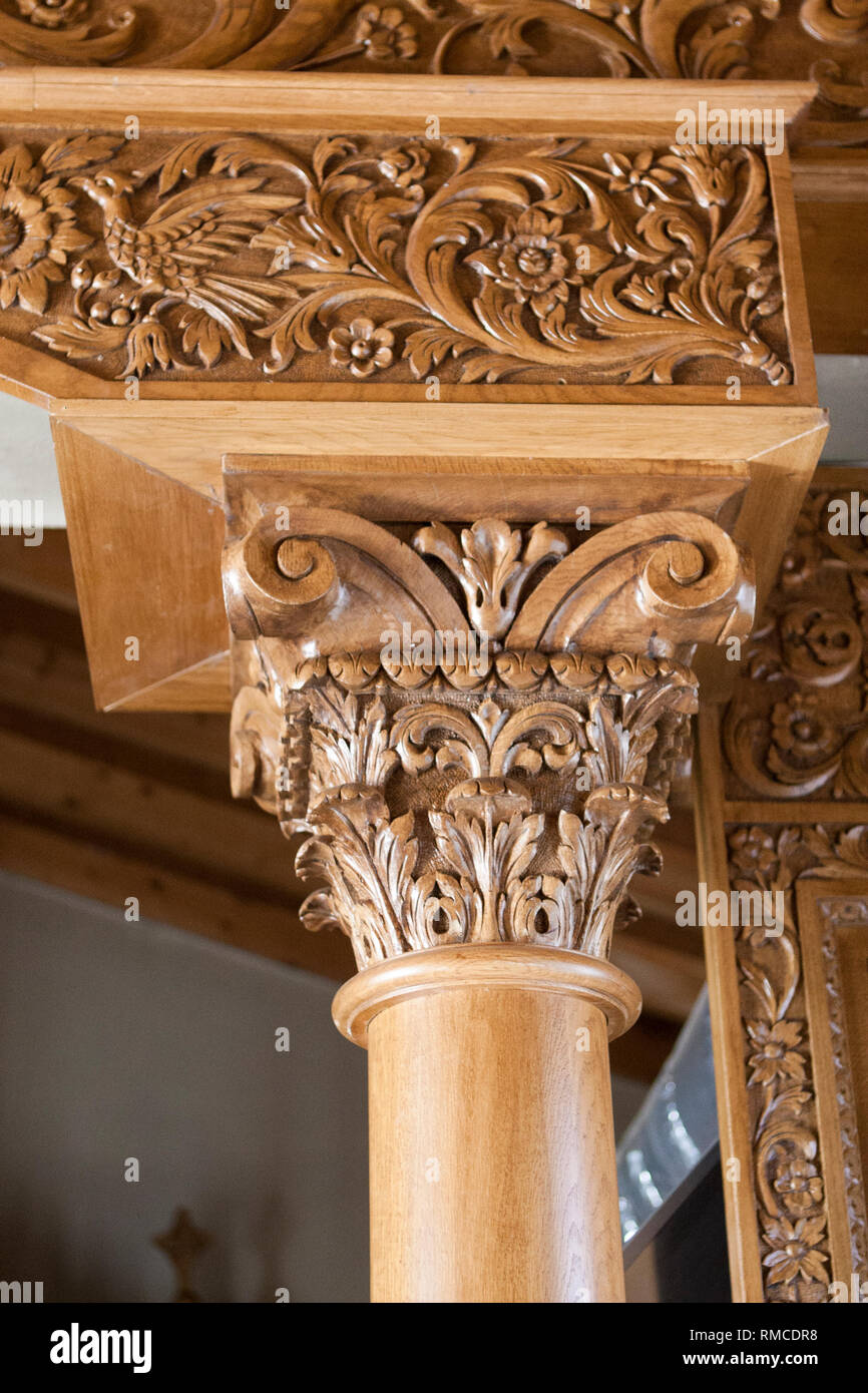 ornate carved church pillar - Stock Image