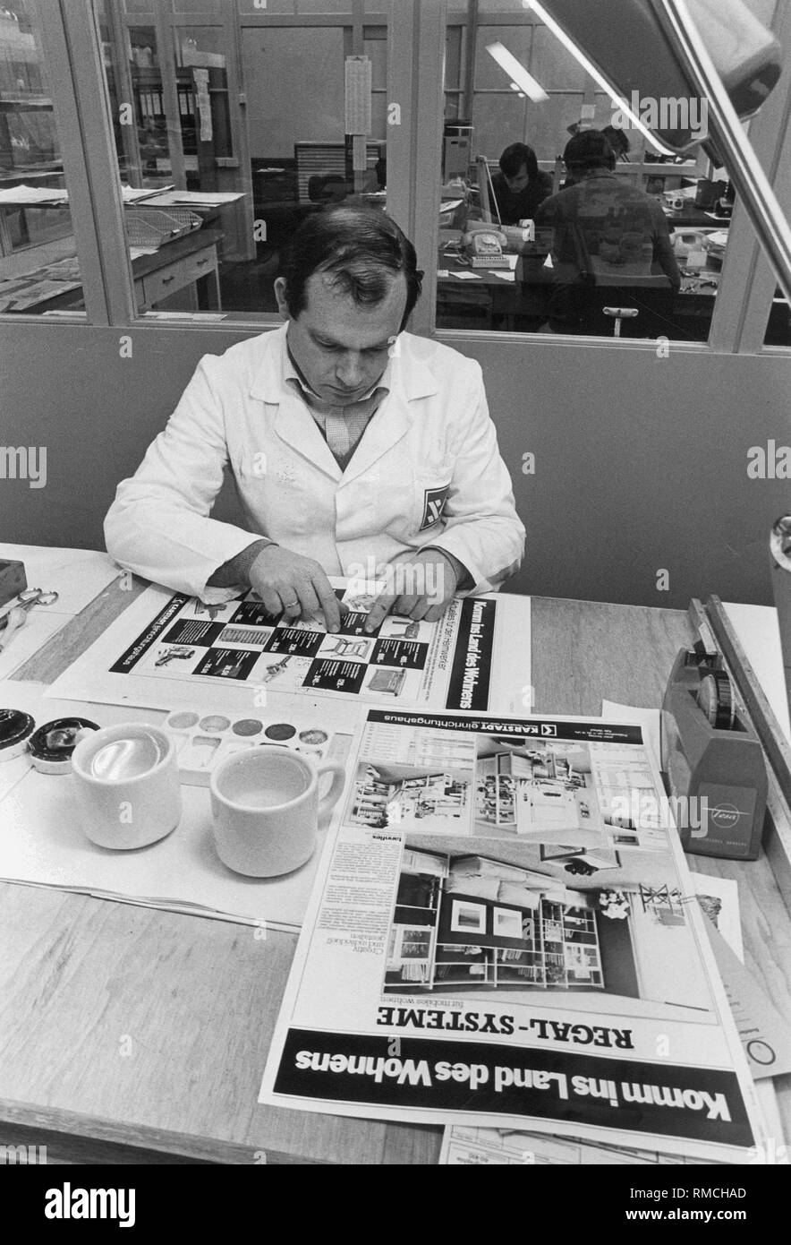 An employee arranges a newspaper supplement for the Sueddeutsche Zeitung, in this case a page of the Karstadt department store. - Stock Image