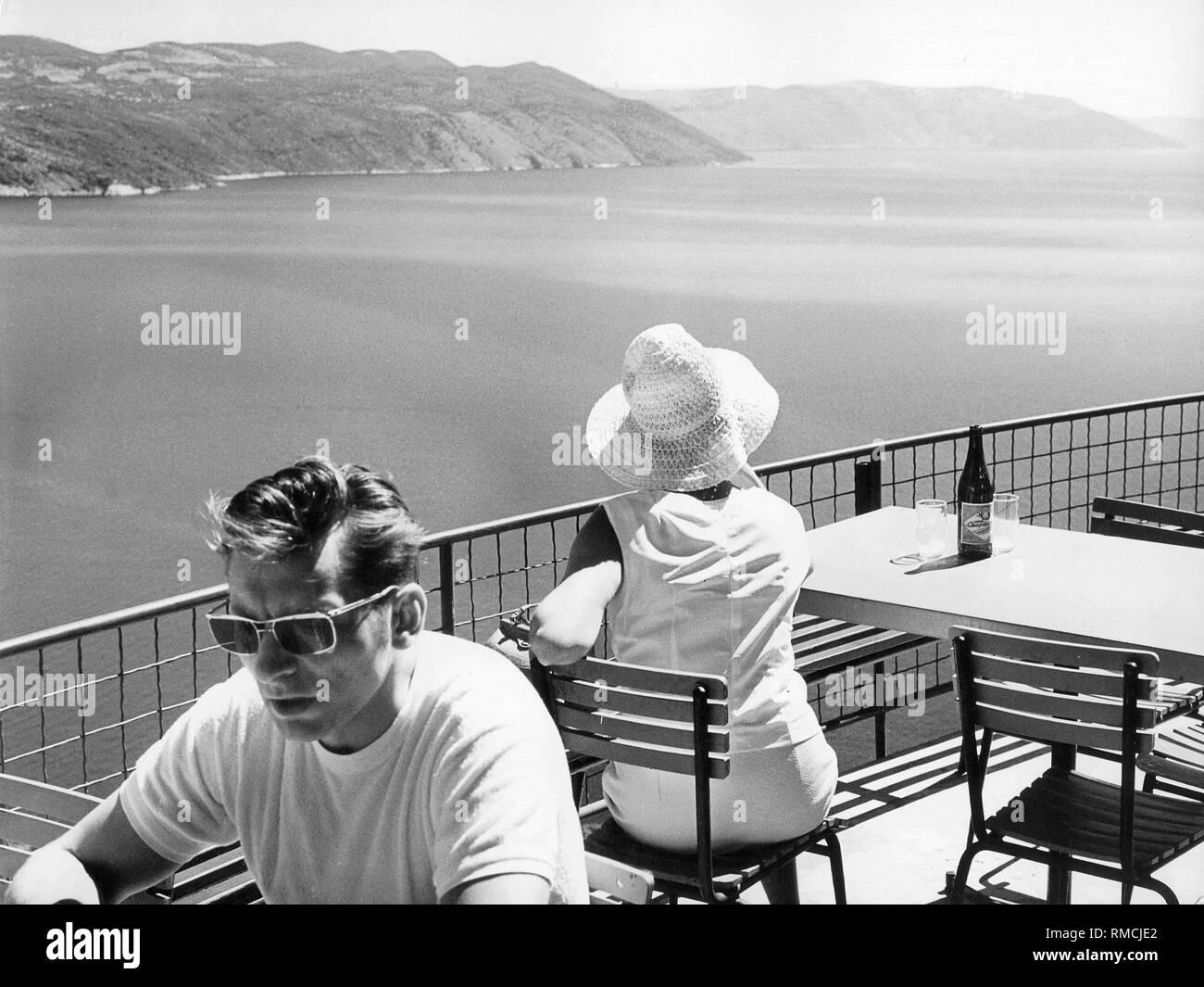 Panoramic cafe overlooking the Gulf of Rijeka near Plomin on the Yugoslavian Adriatic coast. - Stock Image