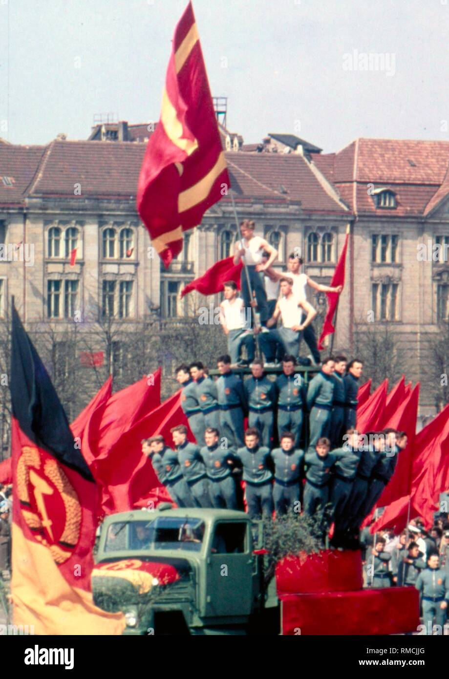 Members of the premilitary Gesellschaft fuer Sport und Technik (GST), (English: Sport and Technology Association) and the army sports club ASK Vorwaerts at a rally on May 1, 1959 on the Marx-Engels-Platz in East Berlin. - Stock Image