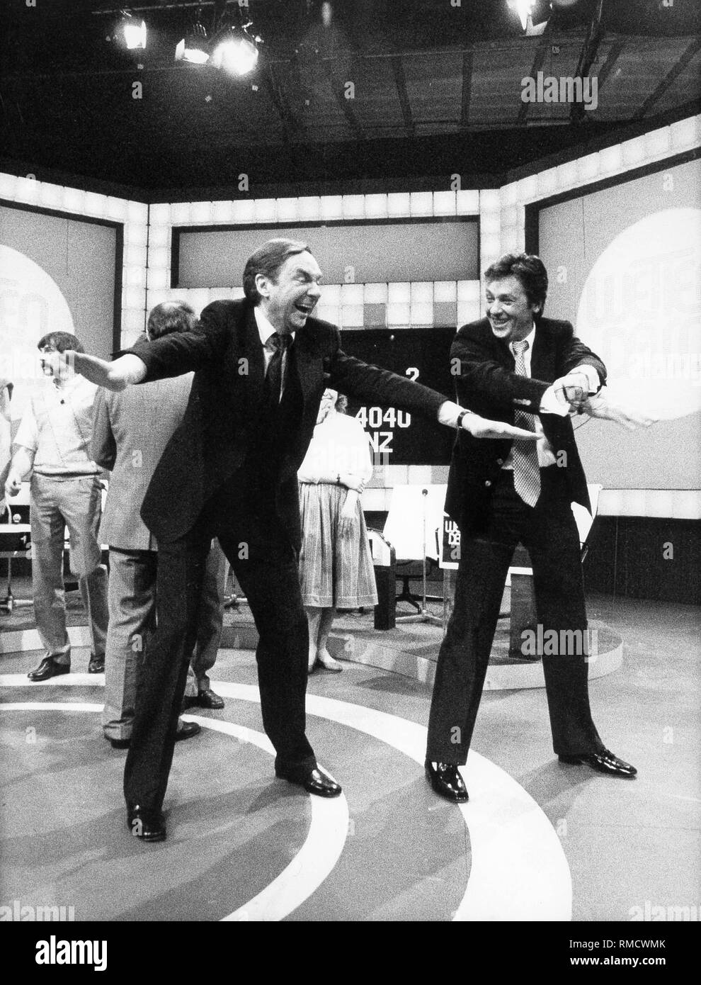 Harald Juhnke with Alain Delon in a show of 'Wetten, dass...'.. - Stock Image