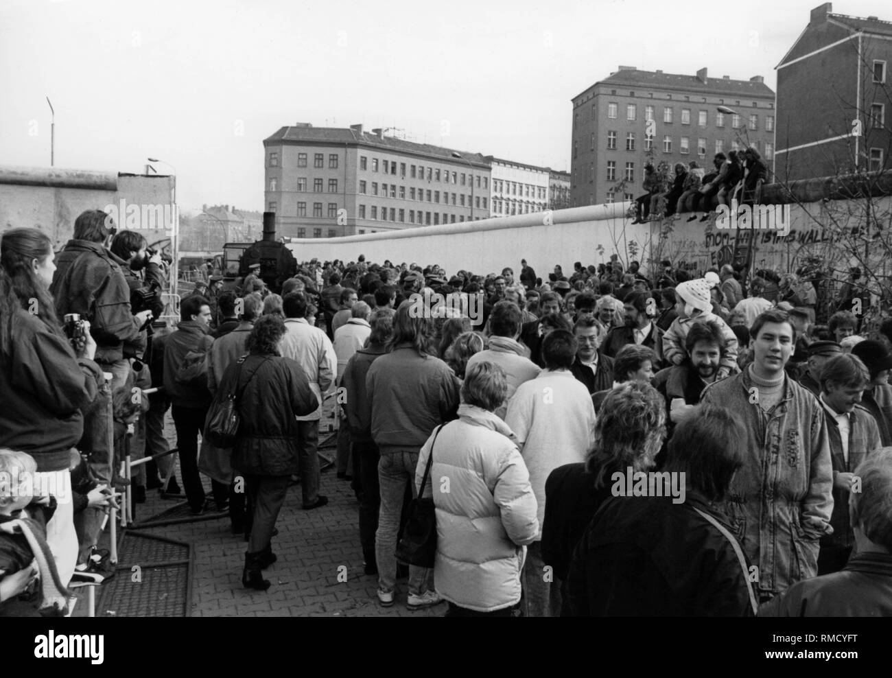 After the fall of the Berlin Wall, numerous East Berliners visit West Berlin, where they are received. Stock Photo