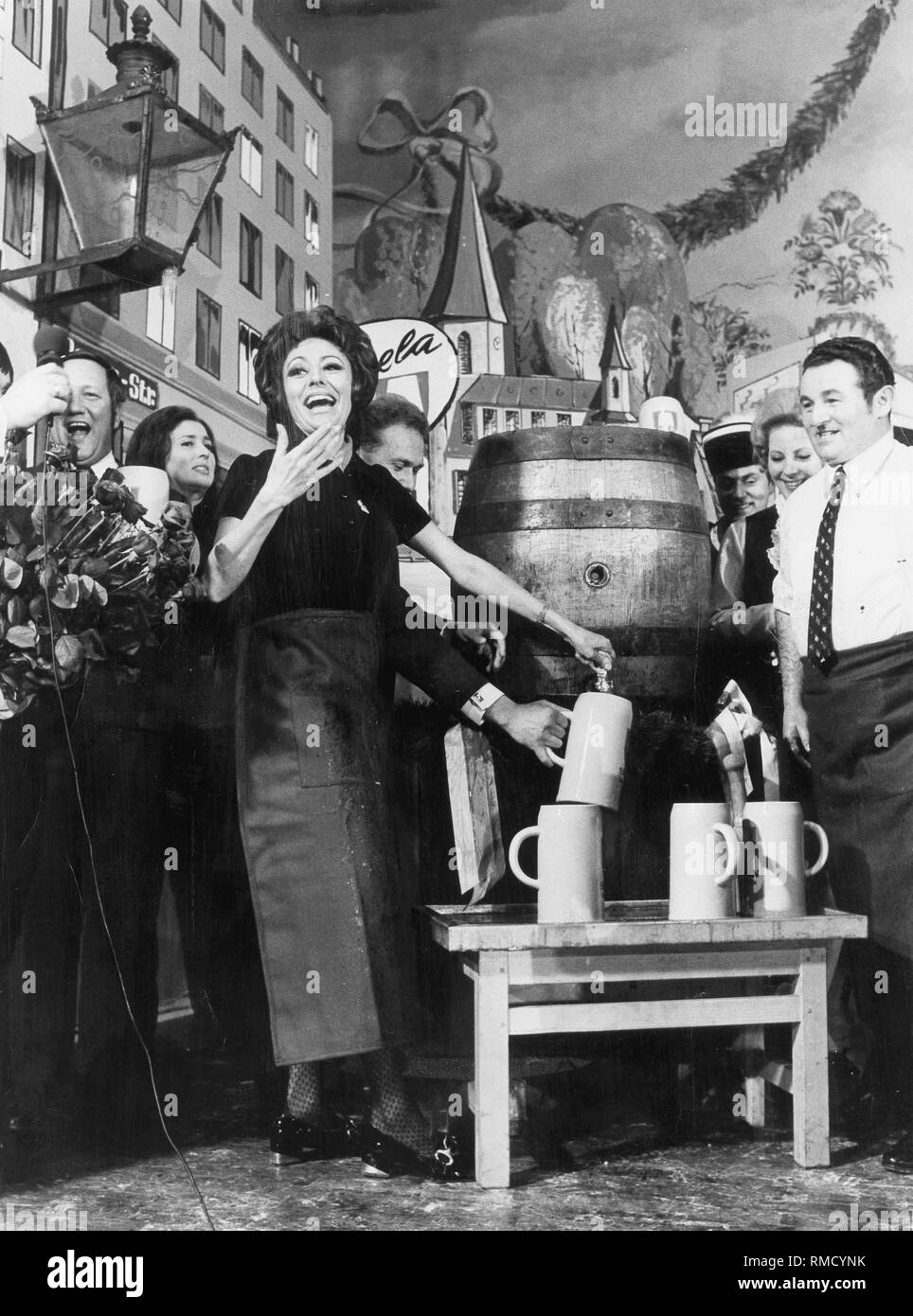 Caterina Valente, a German actress and entertainer, tapping the strong beer. - Stock Image