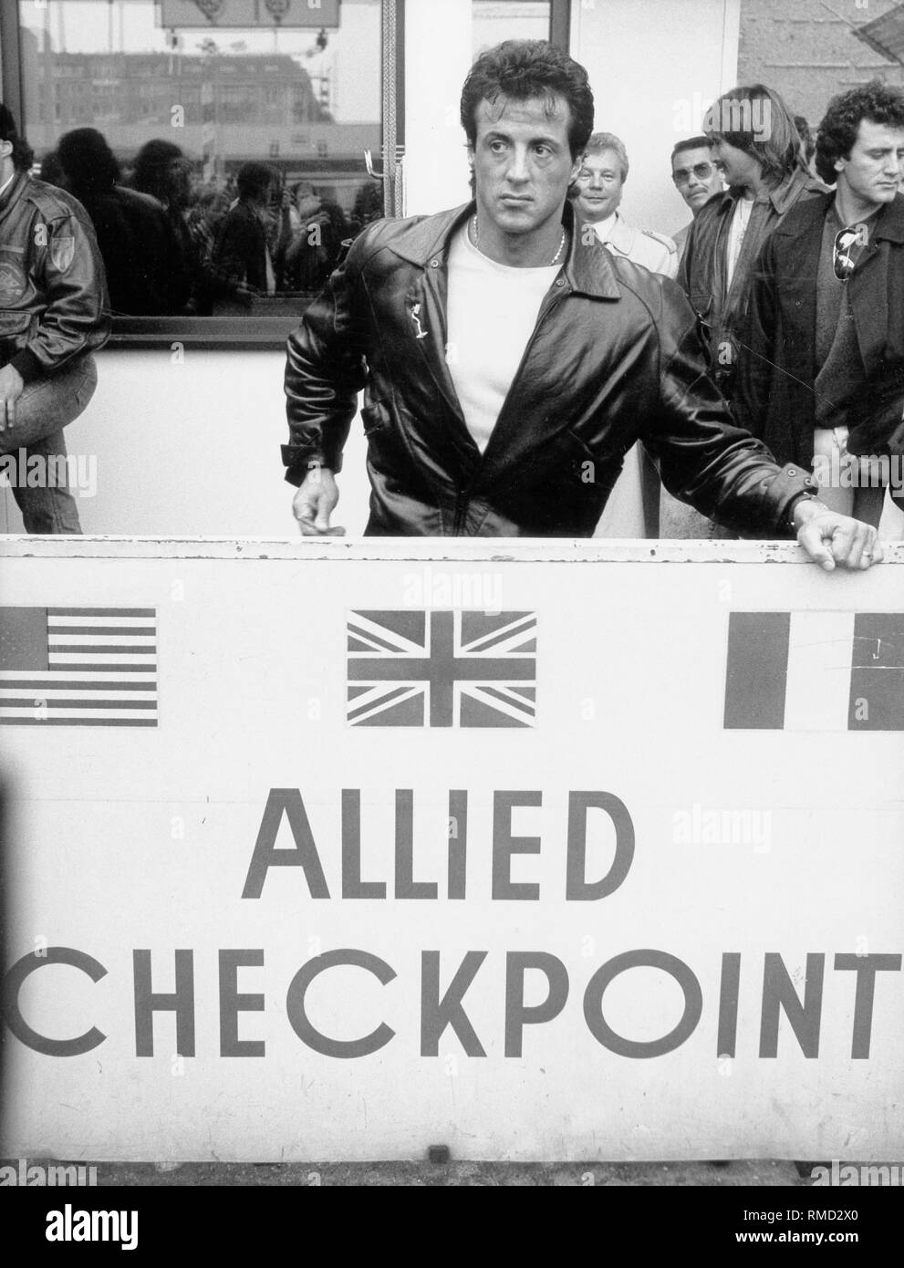 The actor Sylvester Stallone during a visit to Berlin at Checkpoint Charlie. - Stock Image