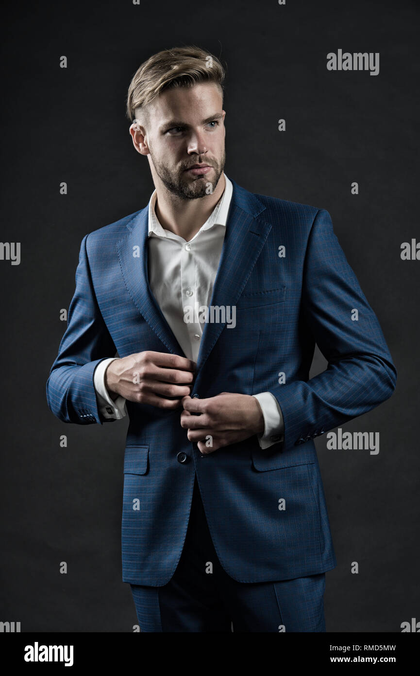 Stylish and successful. Most businesses explicit saying dress code professional attire no second guessing. Man well groomed formal suit dark background. Business dress code. Guy formal outfit. - Stock Image