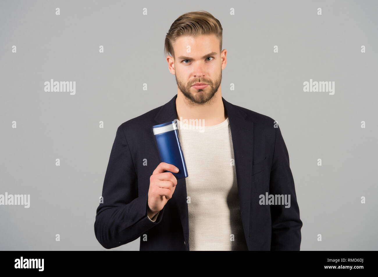 Confident in hair care product. Man stylish hairstyle holds ...