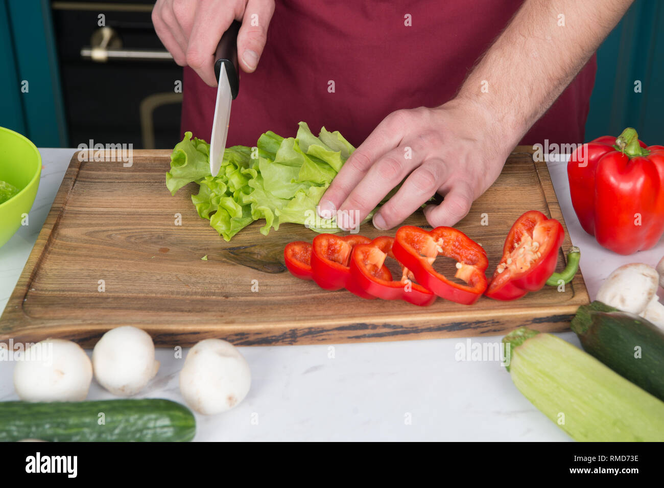 Be careful with knife. Chef teaches how quickly chop vegetables. Chop food safely and efficiently, ensure that you use the right tools. Learn how hold knife correctly and use right chopping technique. - Stock Image