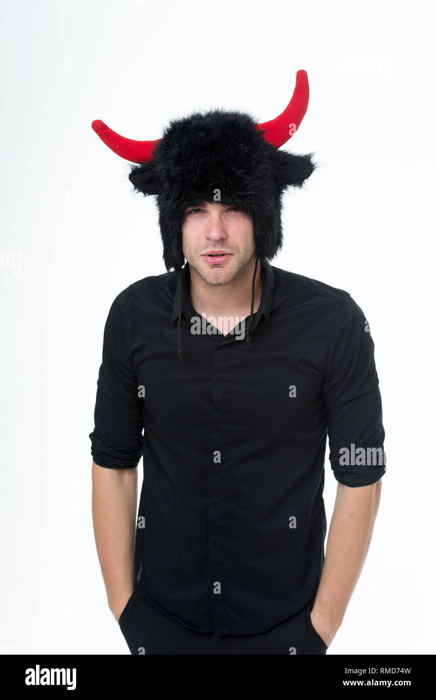 Keep cool and maintain composure. Aggressive intimidating and controlling individuals like to deliberately upset you. Keep calm and ignore aggression. Man horns as devil or bull. Ignore provocation. - Stock Image