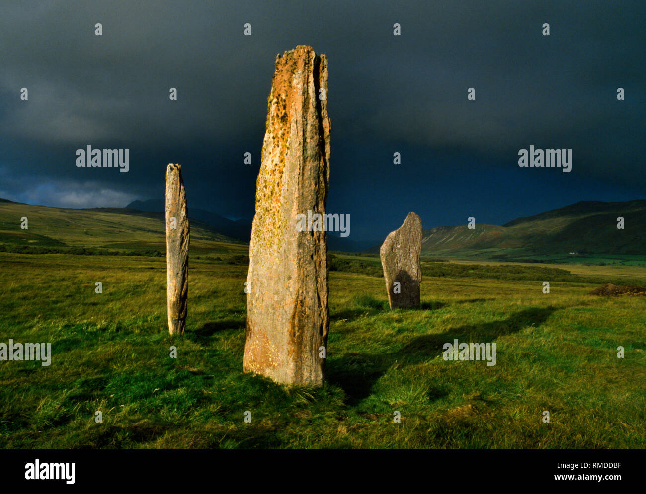 Machrie Moor stone circles, Arran, Scotland, UK: three sandstone slabs of Circle II looking NE to the peak of Goat Fell (behind centre stone). Stock Photo