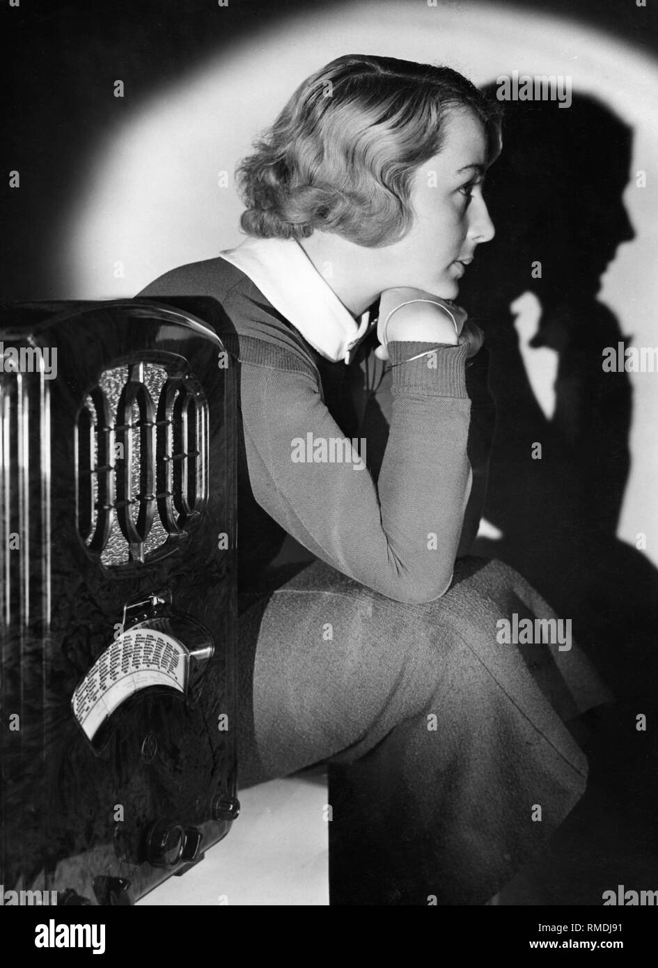 A young women listens to the radio. Advertising shot. Undated picture. Stock Photo