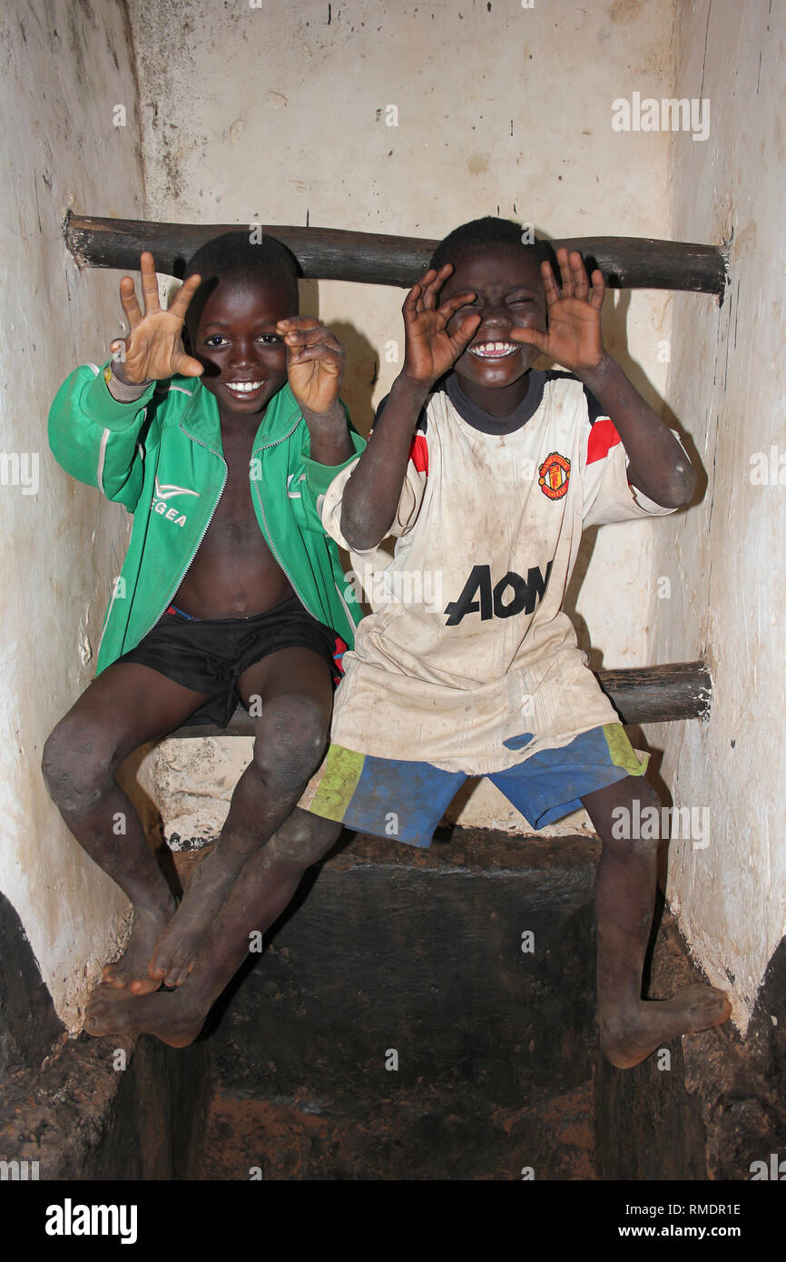 Cheeky Ghanaian Boys Pretending to be Scary Lions - Stock Image