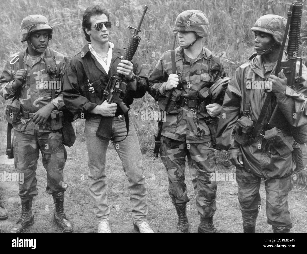 The actor Sylvester Stallone visits American troops in Berlin and appears, among others, with an M-16 assault rifle. - Stock Image