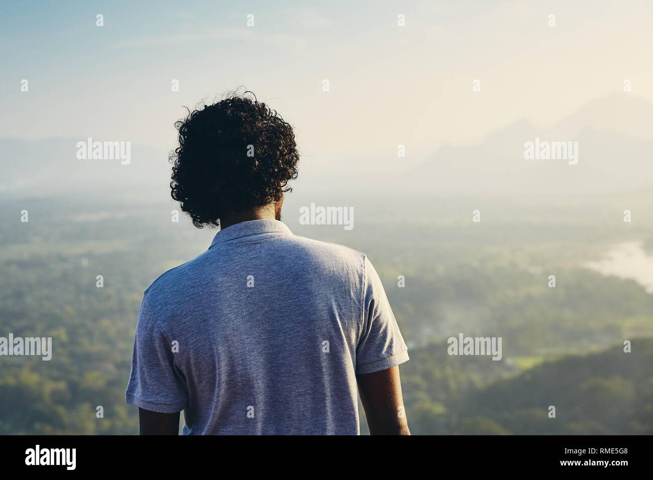 Young man contemplation at the sunset. View from Sigiriya rock in Sri Lanka. - Stock Image