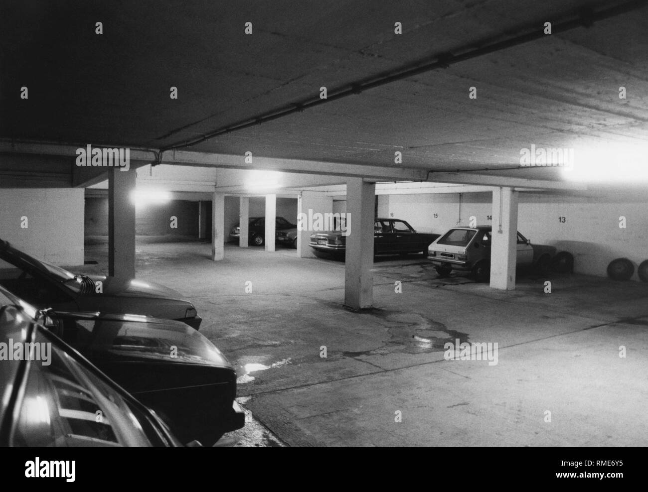 An underground car park in 1985. In the background, a VW Golf I and a Mercedes S-Class (W116). - Stock Image