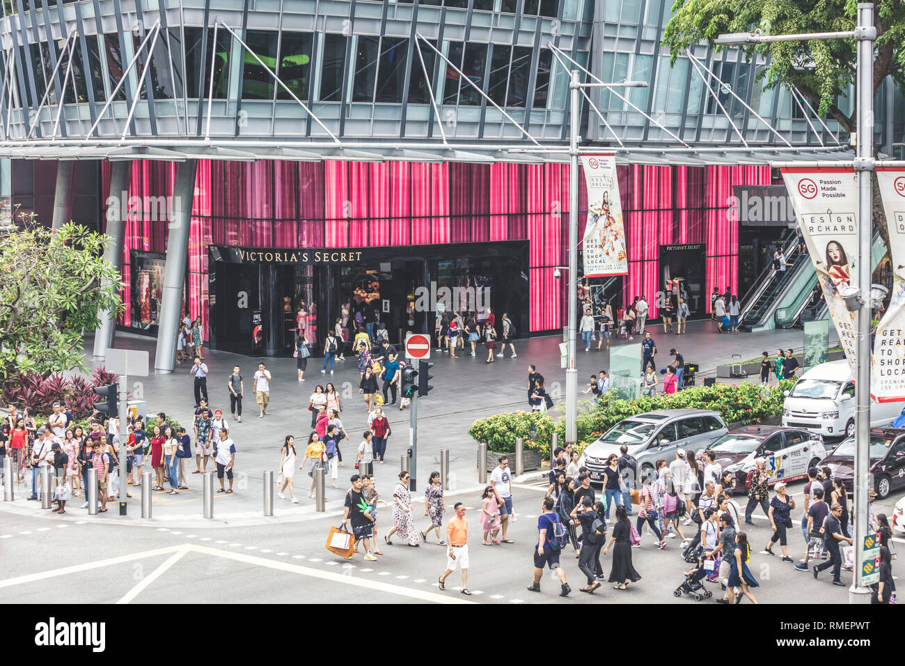 Singapore / Singapore - February 10 2019: Pedestrian traffic scramble road crossing at Orchard Road Somerset junction featuring Victoria Secret store - Stock Image
