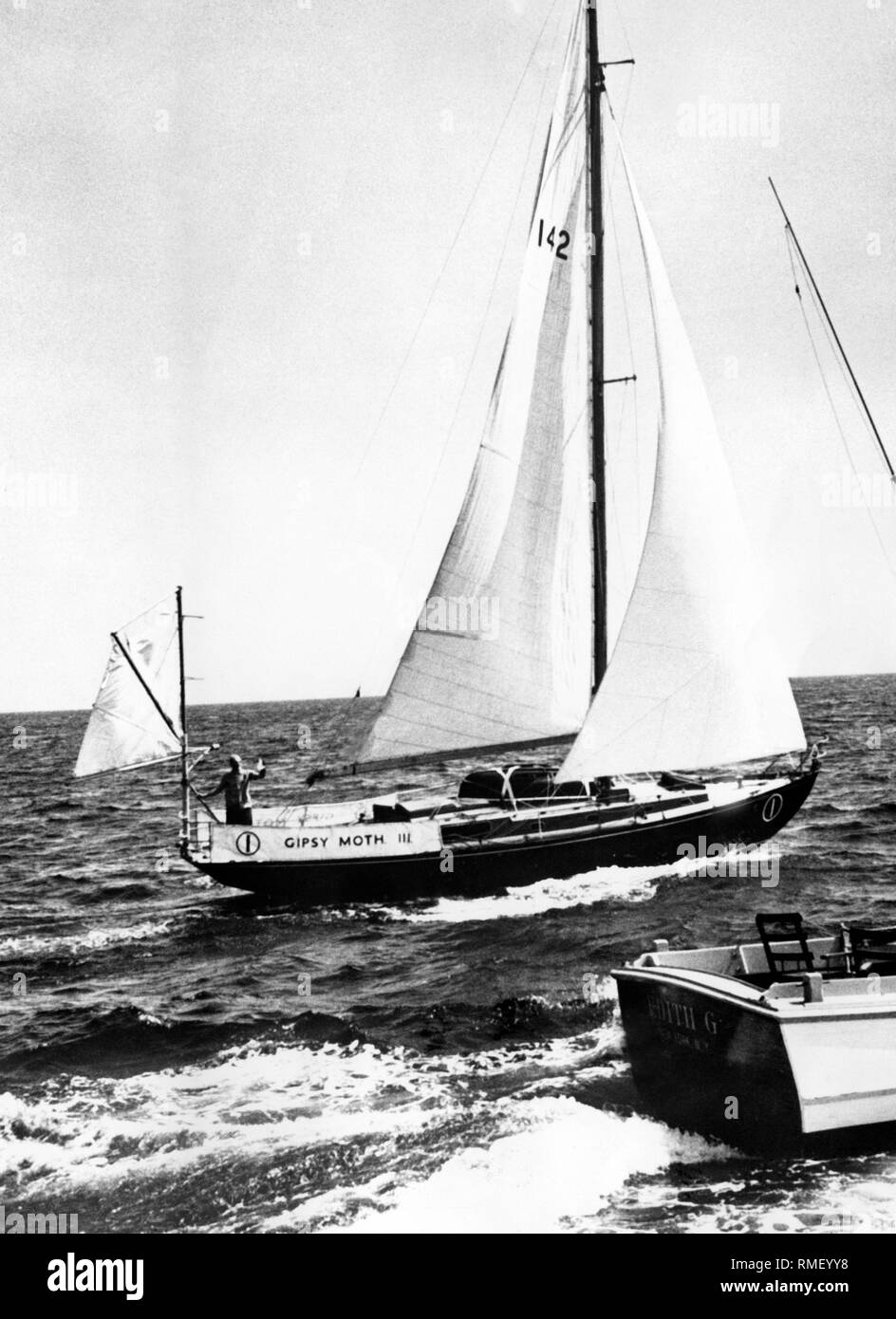 Francis Chichester Sails With His Boat The Gipsy Moth Stock