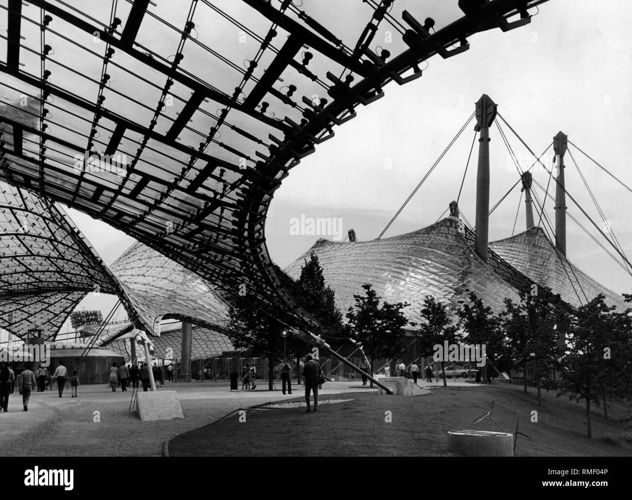 View from the forecourt onto the Olympic Stadium (Olympiastadion) in Munich with its tent roof construction. - Stock Image
