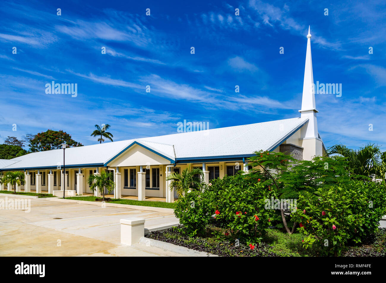 Typical Mormon church (The Church of Jesus Christ of Latter-day Saints) in rural Oceania. Tongatapu Island​, Tonga, Polynesia, South Pacific Ocean. - Stock Image