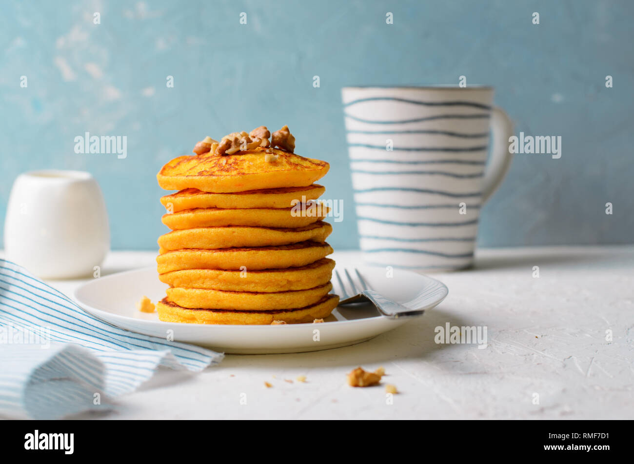Pumpkin or Carrot Pancakes with Nuts, Stack of Homemade Pancakes on Bright Background Stock Photo