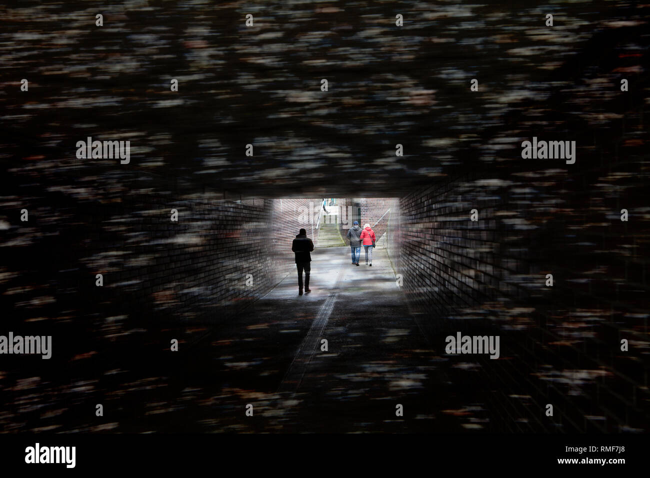 Walking in a dark tunnel, Germany - Stock Image