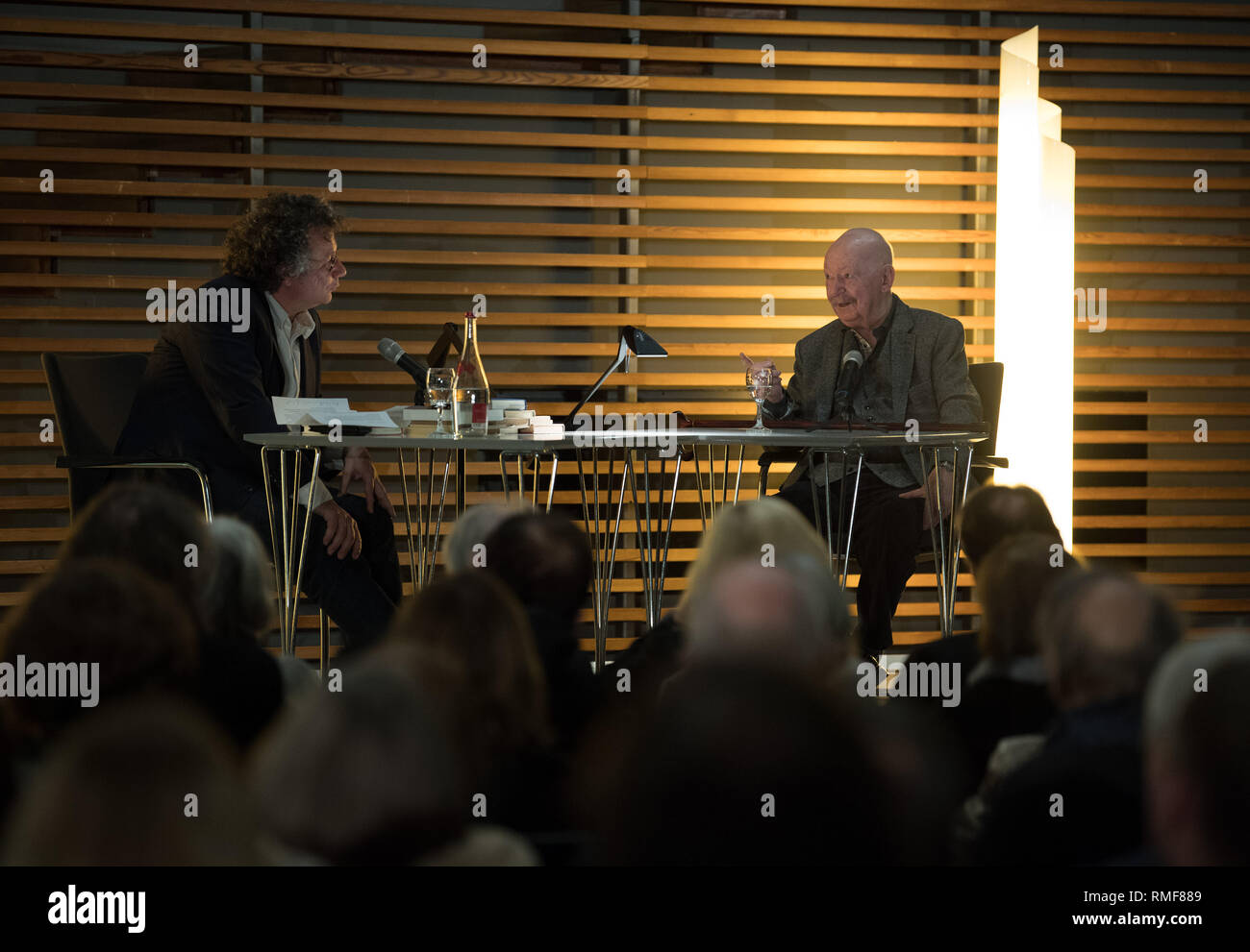 Berlin, Germany. 14th Feb, 2019. The writer Günter Kunert (r) talks to the writer Ingo Schulze about his book 'Die zweite Frau' ('The Second Woman'), which has now been published by Wallenstein-Verlag, in the Schleswig-Holstein state representation. Kunert had written the novel almost 45 years ago, when he found the book unprintable in the GDR and had forgotten the manuscript in its hiding place. Credit: Soeren Stache/dpa/Alamy Live News - Stock Image