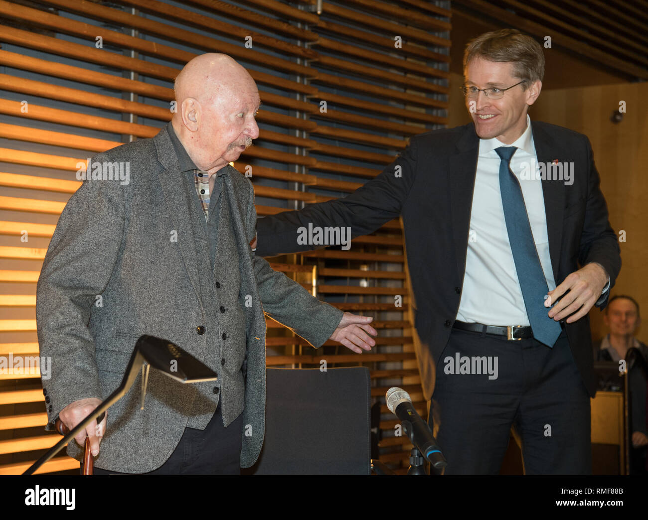 Berlin, Germany. 14th Feb, 2019. The writer Günter Kunert (l) and Daniel Günther (CDU), Minister President of Schleswig-Holstein, welcome each other in the state representation of Schleswig-Holstein before a conversation about the book 'The Second Woman'. Kunert had written the novel almost 45 years ago, found the book unprintable in the GDR at the time, and at some point forgotten the manuscript in its hiding place. Now the book has been published by Wallstein-Verlag. Credit: Soeren Stache/dpa/Alamy Live News - Stock Image