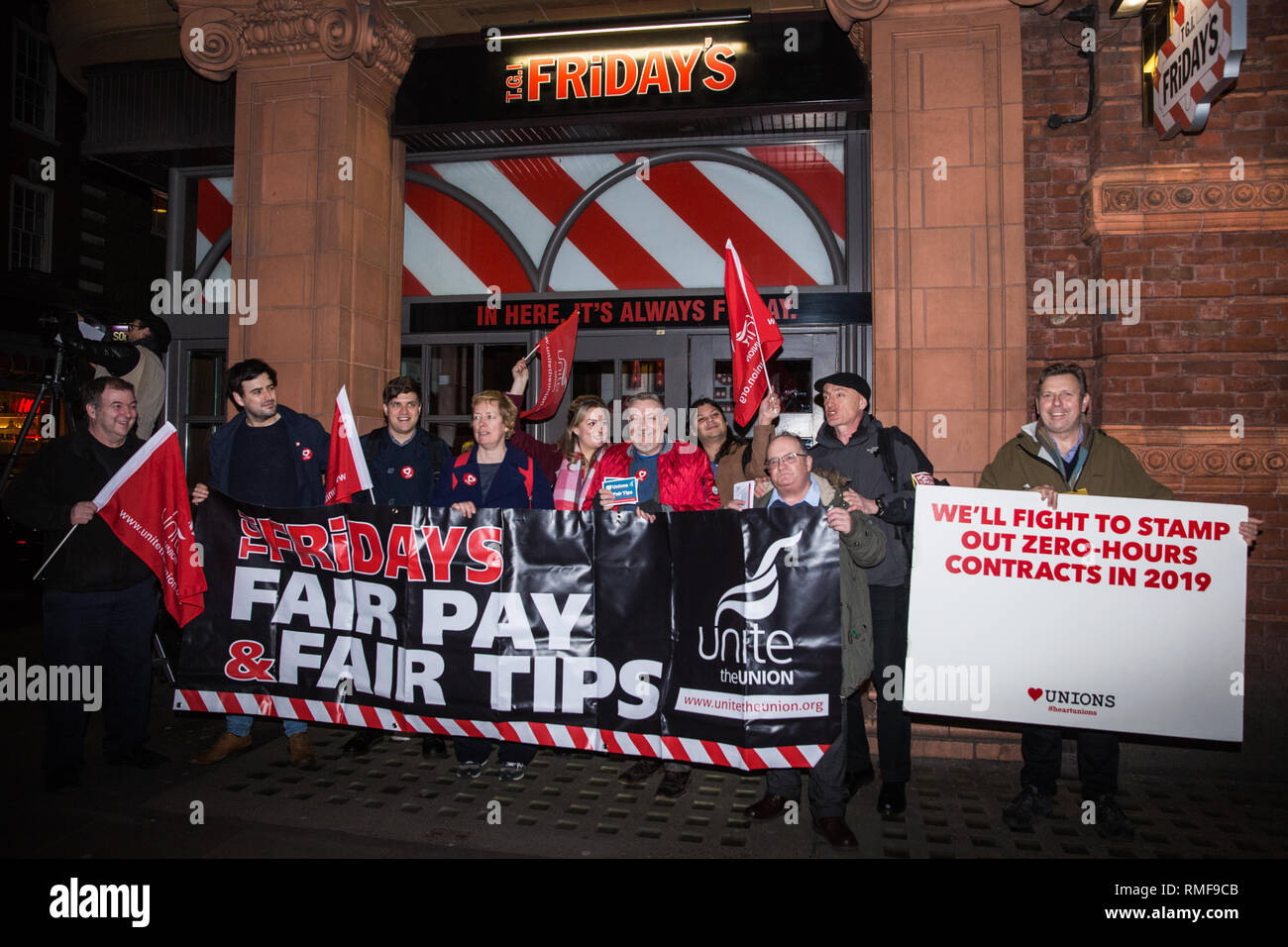 London, UK. 14th February, 2019. Members and supporters of the Restaurant, Catering and Bar Workers Branch of Unite the Union mark the first anniversary of a strike - since ended - for fair tips and fair pay by TGI Fridays workers outside a branch of the chain in Covent Garden. Unite plan to call on HMRC next week to conduct two investigations into the conduct of TGI Fridays, one regarding their Tronc scheme for tips and the other regarding minimum wage issues. Credit: Mark Kerrison/Alamy Live News - Stock Image