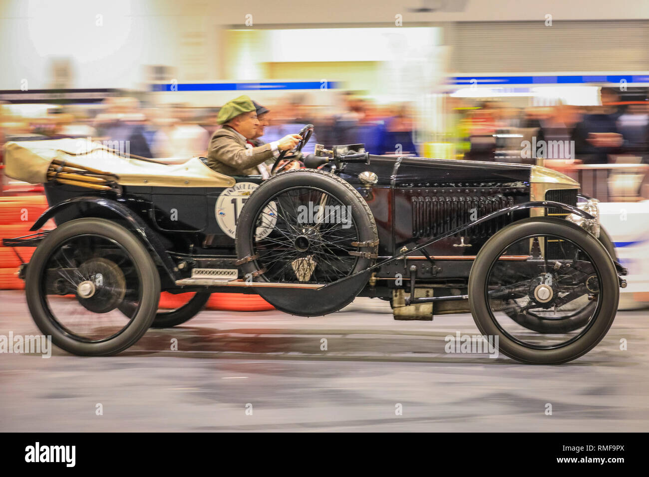 excel, london, uk, 14th feb 2019. a vintage car races down the grand