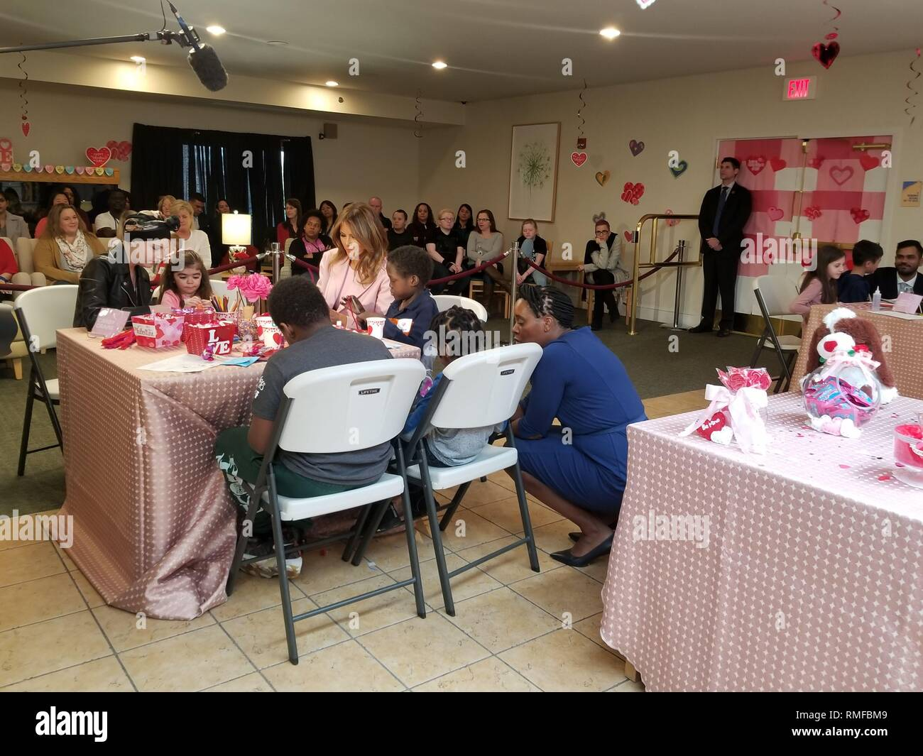 BETHESDA, MD FEBRUARY 14: Dressed in all pink, first lady Melania Trump brought ValentineÕs Day cards to young patients being treated at the ChildrenÕs Inn at the National Institutes of Health. Meet Amani. He is 13 yrs old & just completed his first treatment today.  He gave FLOTUS a necklace inscribed w/ ÒFaithÓ & ÒHopeÓ - two words he keeps close during treatments. He has a bracelet he will wear to match FLOTUS on Thursday February 14, 2019 IN Bethesda, MD  People:  First Lady Melania Trump - Stock Image