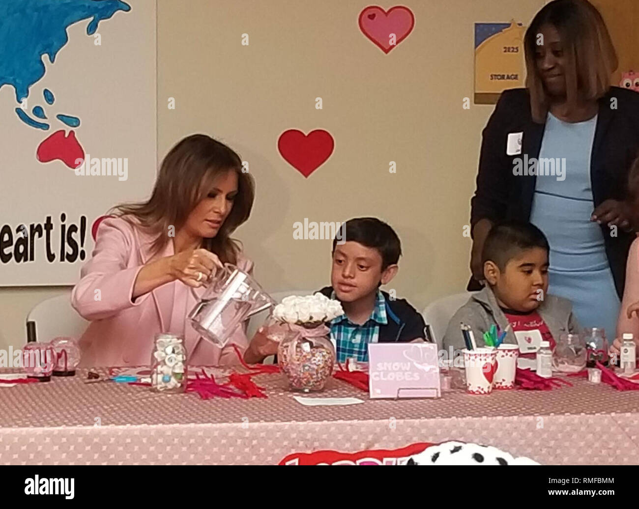"BETHESDA, MD FEBRUARY 14: Dressed in all pink, first lady Melania Trump brought Valentine's Day cards to young patients being treated at the Children's Inn at the National Institutes of Health. Meet Amani. He is 13 yrs old & just completed his first treatment today.  He gave FLOTUS a necklace inscribed w/ ""Faith"" & ""Hope"" - two words he keeps close during treatments. He has a bracelet he will wear to match FLOTUS on Thursday February 14, 2019 IN Bethesda, MD  People:  First Lady Melania Trump - Stock Image"