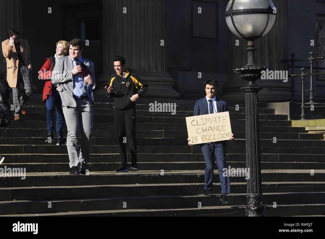 Liverpool, UK, Friday 15th February 2019, Student strike organised by a student grassroots movement, UK Student Climate Network and Schools 4 Climate Action with flags and placards on St George's Plateau, Liverpool city centre. Credit David J Colbran / Alamy Live News Stock Photo