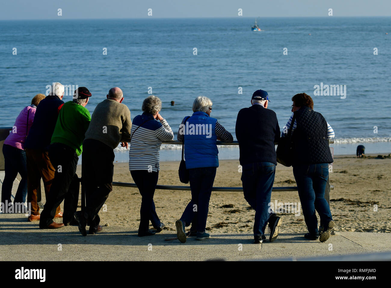 Lyme Regis, Dorset, UK. 15th Feb, 2019. UK Weather. A Large group of people enjoying Lyme Regis in Dorset on a Warm and sunny afternoon in February 2019/Picture Credit; Credit: Robert Timoney/Alamy Live News - Stock Image