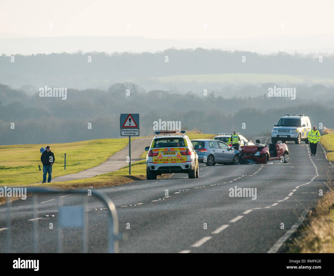 Gullane, East Lothian, Scotland, United Kingdom, 15th February 2019. Two cars involved in a collision crash on the A198 coast road between Aberlady and Gullane on the straight section outside Gullane golf course on West Links Road. The crash happened around 1.00pm and the was closed for hours. Three pensioners involved in the collision were taken to hospital - Stock Image