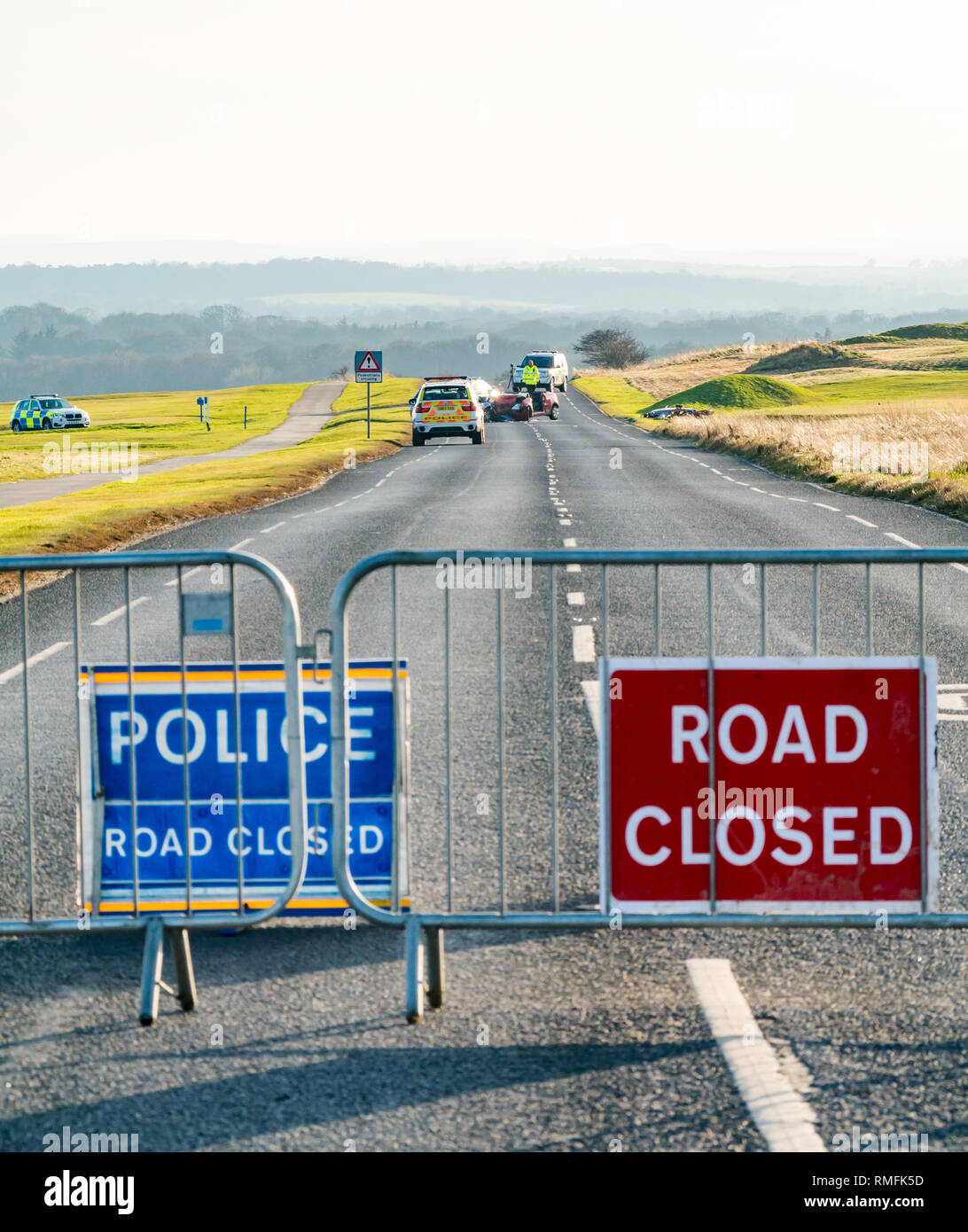 Gullane, East Lothian, Scotland, United Kingdom, 15th February 2019. Two cars involved in a collision crash on the A198 coast road between Aberlady and Gullane on the straight section outside Gullane golf course on West Links Road. The crash happened around 1.00pm and the was closed for hours. Noone was  seriously injured but one person was taken to hospital. The police close the road with barriers and road closed signs. Three pensioners involved in the collision were taken to hospital - Stock Image