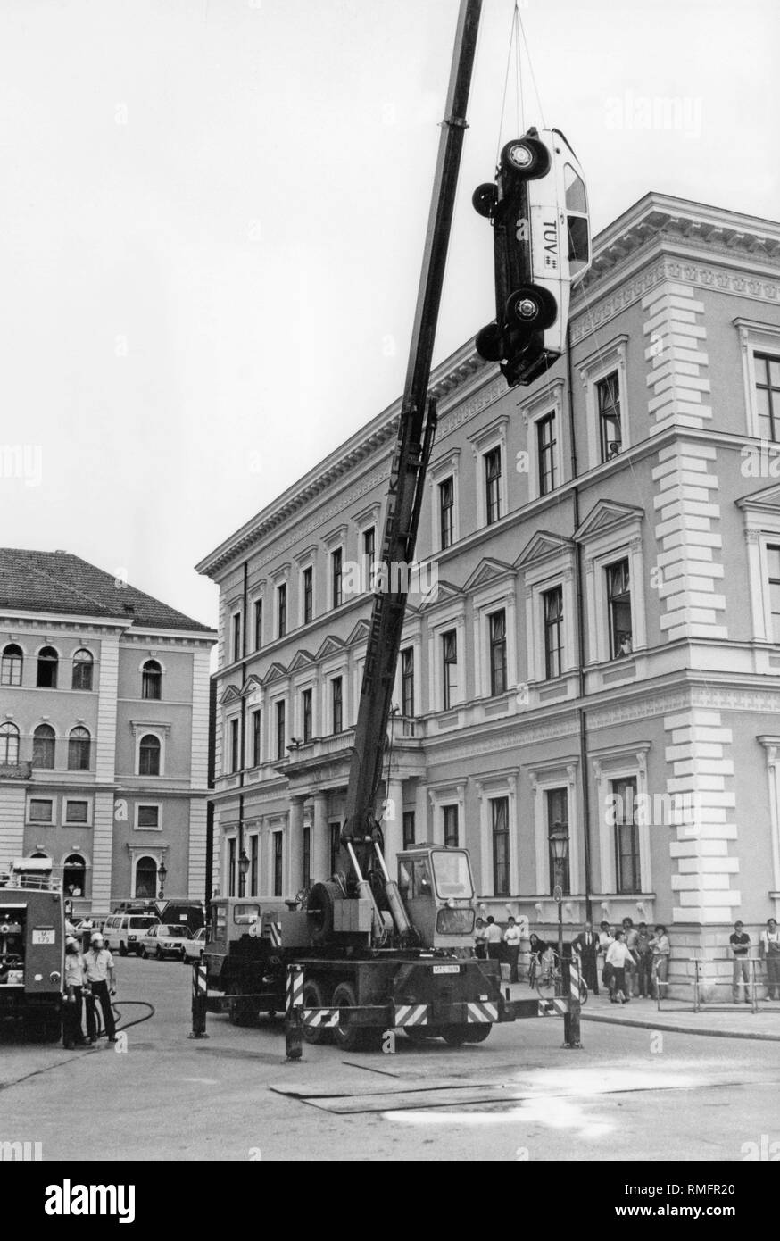 Public crash test of TUV Bayern. A VW Golf I is dropped by a crane from a height of 10 meters. The impact corresponds roughly to a frontal accident at 50 km / h. - Stock Image