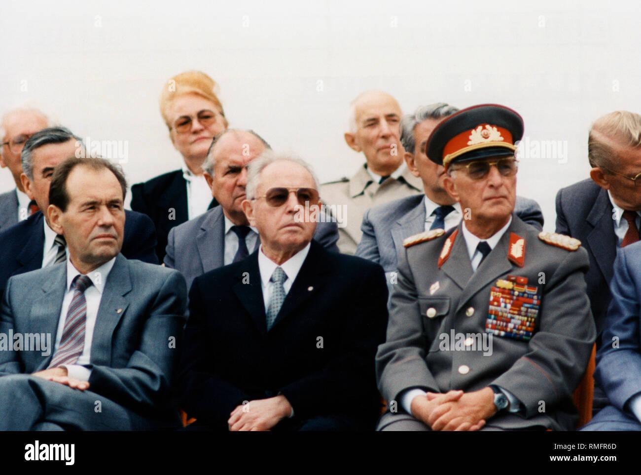 Politburo member Joachim Herrmann, Stasi chief Erich Mielke and Defense Minister, Army General Heinz Kessler (front from left) before a mass rally on Bebelplatz in Unter den Linden Strasse. - Stock Image