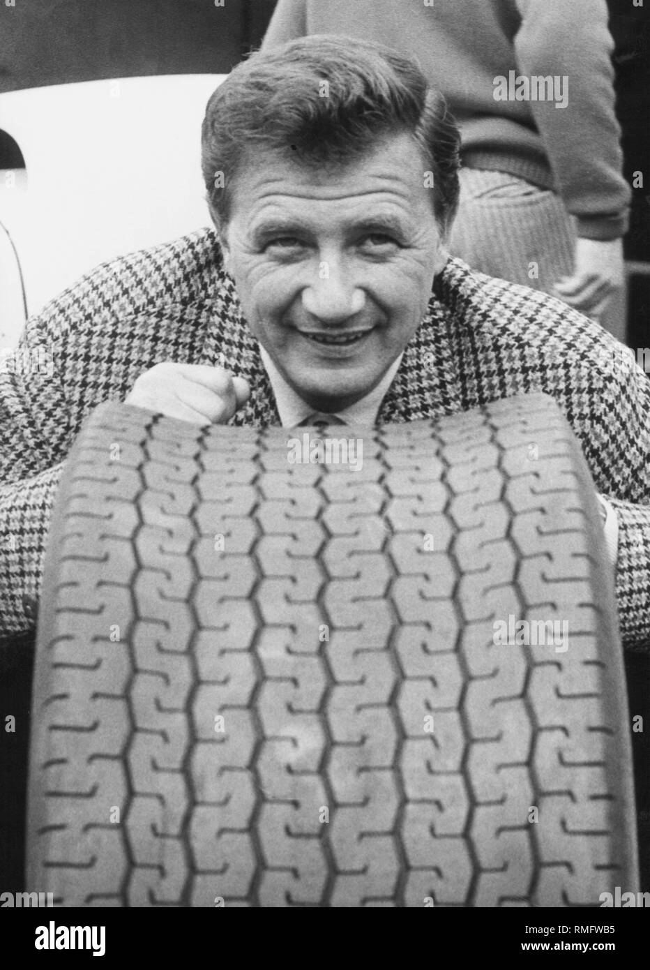 Racing driver Hans Herrmann with a wheel. - Stock Image