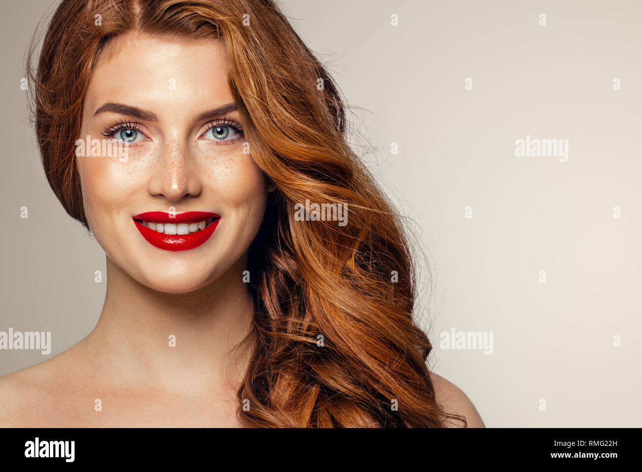 Candid woman with freckles and ginger hair. Natural redhead girl lifestyle  portrait - Stock Image